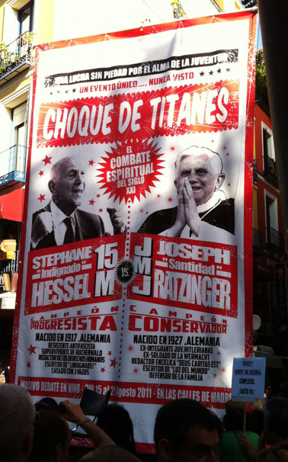 "Poster with photos of Stéphane Hessel, author of the book ""Indignaos"" and inspiration for the movement and Pope Benedicto. Photo from Juan Luis Camacho, taken from www.laicismo.org."