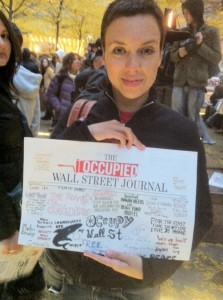 Photo of Mariné Pérez with the fourth edition of Occupy Wall Street Journal, taken by Chris Theokas.