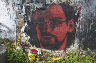 Edward Snowden is revered by those who defend personal freedoms, but is also criticized for treason to his country, the United States. Photo from Flickr/Adobe of Chaos (CC BY 2.0).