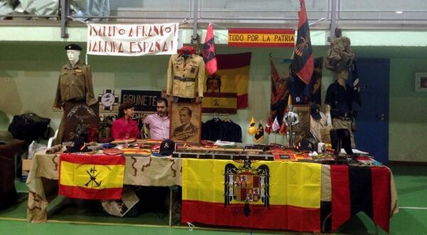 One of the market stalls, where items displaying Francoist symbols can clearly be seen. Photo uploaded to Twitter by Julio no surname