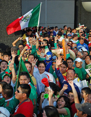 Image of Mexican sports fans shared on Flickr by the user James Willamor. Used under CC 2.0 license.