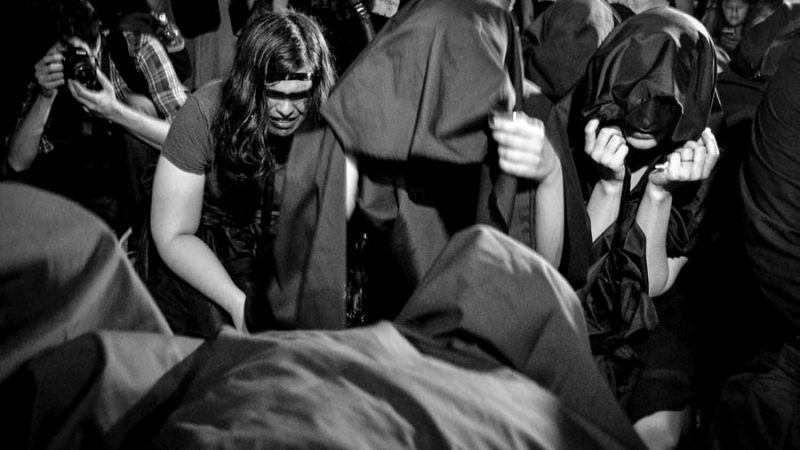 "A group of women portraying ""The Weeping Women"" as a form of pain from and repudiation of the femicides that occur in the country and in the region. This took place at the international protest #NiUnaMenos (#NotOneLess) that occurred in Asunción this past October 19th in front of the Pantheon of the Heroes. Photograph by Jessie Insfran Pérez, taken from Kurtural's main page and used with permission."